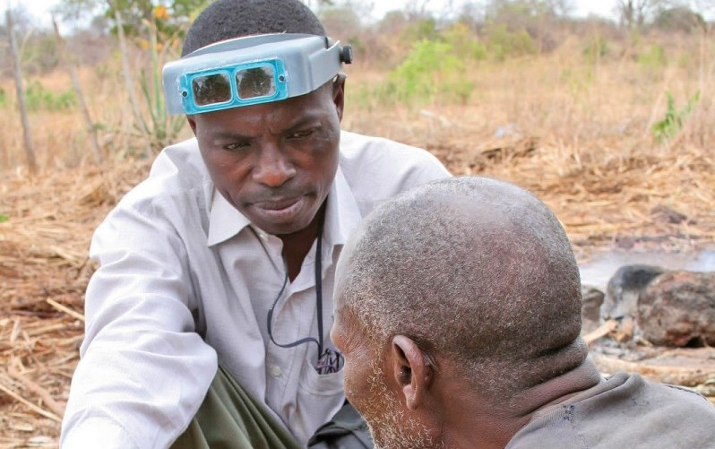 An eye care worker consulting with a patient in the community. TANZANIA. © Lance Bellers/Sight Savers