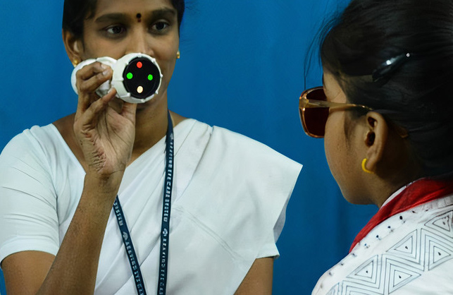 Female ophthalmic staff and female patient