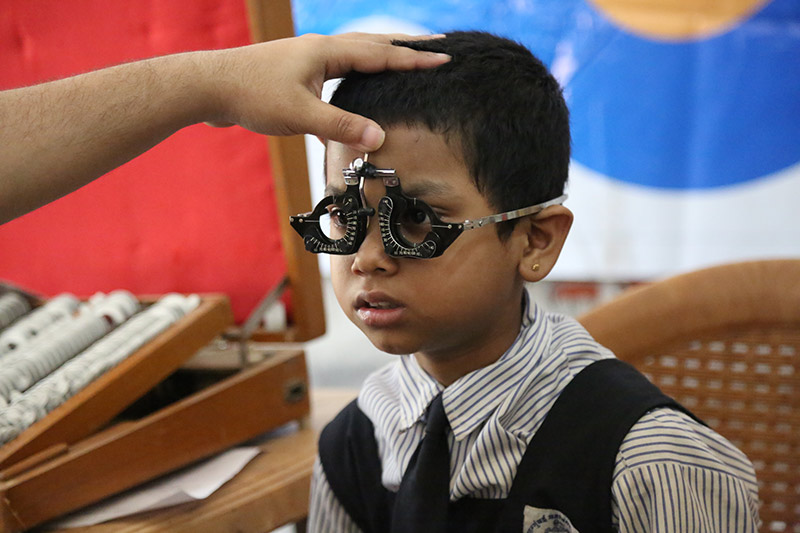 Child wearing a trial frame