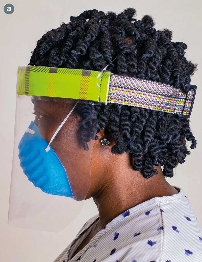 Female health worker wearing a homemade face shield and a blue face mask