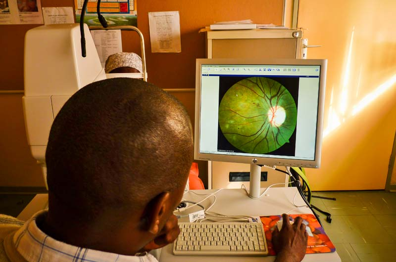Nurse Baele Fidzani grades an image at Donga Diabetes Centre, Francistown. BOTSWANA. Peter Blows