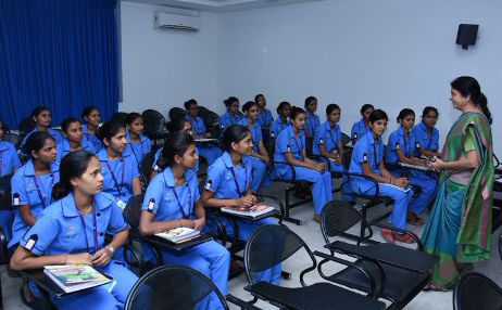 a classroom full of nursing students with their tutor
