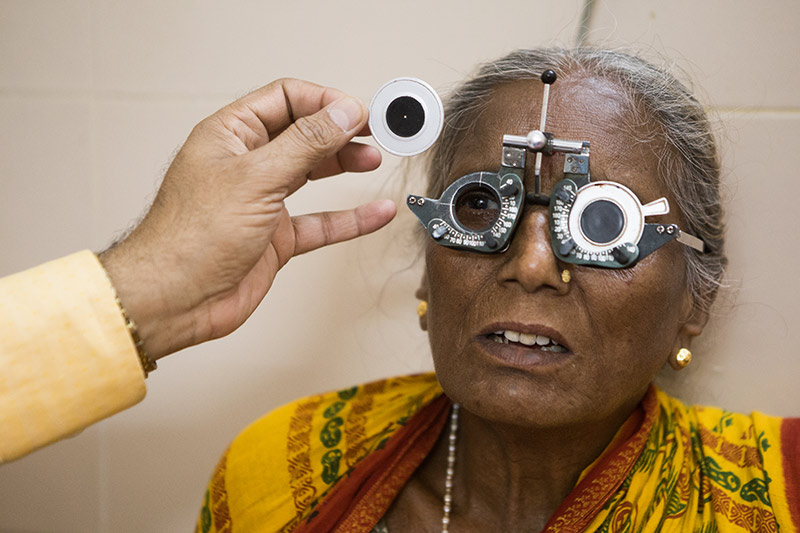 Elderly lady wearing refracting spectacles