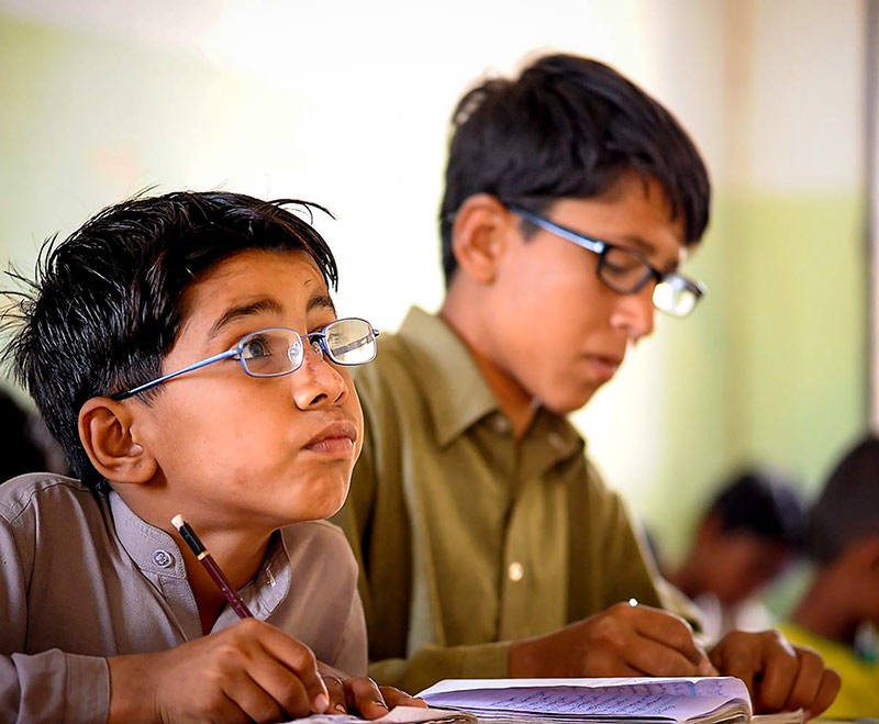 Two boys working in class