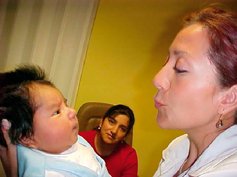 Female ophthalmologist holding a young baby