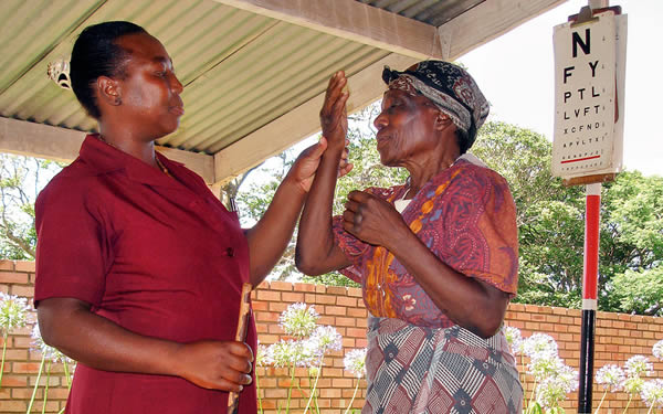 An older women has her vision tested. SWAZILAND. © Daisy Wilson