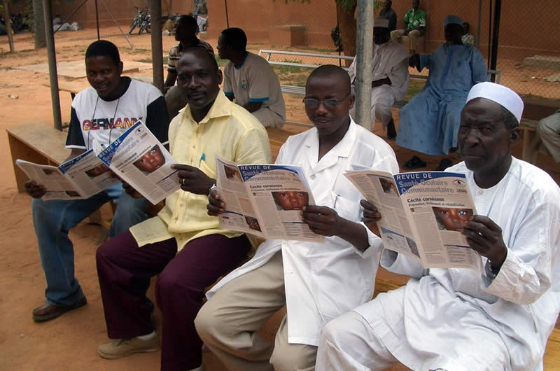 Winner of the 2011 Community Eye Health Journal Photograph Competition: Four nurses reading the French edition of the journal. NIGER. © Andrew Potter.