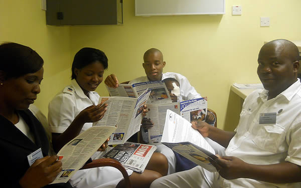 Staff reading the Community Eye Health Journal. BOTSWANA. © Tatowela Mmoloki. 2nd place in the 2011 Community Eye Health Journal Photograph Competition