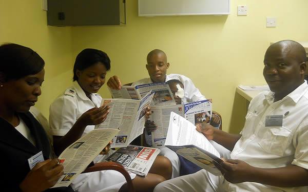 Staff reading the Community Eye Health Journal. BOTSWANA. © Tatowela Mmoloki. 2nd place in the 2011 Community Eye Health Journal Photograph Competition
