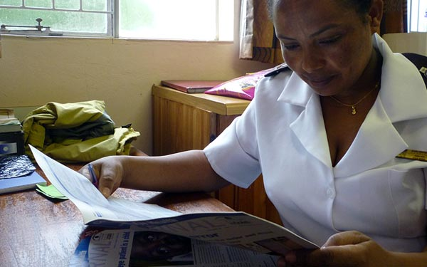Reading the journal on a break. SWAZILAND. Sally Parsley